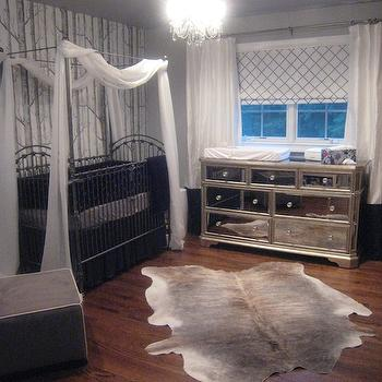 nurseries - rug, abc carpet, cole and sons wallpaper, dresser from ebay, mirrored changing table, dresser as changing table, canopied crib, crib with canopy, woods wallpaper, cowhide rug, lattice roman shade, black crib bedding, Anthropologie Woods Wallpaper,