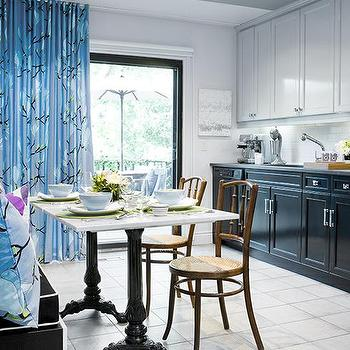 Samantha Pynn - kitchens - marble dining table, french dining table, french marble dining table, blue curtains, white upper cabinets dark lower cabinets, white top cabinets dark bottom cabinets,