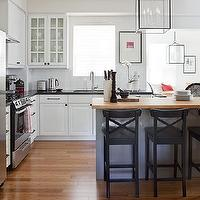 Samantha Pynn - kitchens - white, glass-front, kitchen, cabinets, black, granite, countertops, butcher block, kitchen, island, countertop, black, counter stools, iron, lantern, pendant, white, subway, tiles, backsplash, oak, floors, stainless steel, appliances,