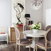 Samantha Pynn - dining rooms - white, pedestal, dining table, lilac, purple, French, Louis, chairs, crystal, chandelier, crow, art, lilac, purple, walls, paint, color, modern, French, dining room, wood, floors, buffet, lamp, black shade, white, bench,