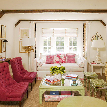 Krista Ewart Design - living rooms - pink chairs, pink tufted chairs, hot pink chairs, hot pink tufted chairs, green coffee table, chinoiserie coffee table, fireplace ottomans, green ottomans, green tufted ottomans, white sofa with pink piping, white and pink sofa, white and pink couch, sofa bolster pillows, rustic wood beams, living room beams, living room wood beams, charming living room,