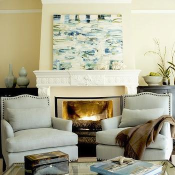 Massucco Warner Miller - living rooms - yellow walls, fireplace art, yellow and blue living room, yellow and blue art, yellow and blue abstract art, art over fireplace, blue chairs, fireplace chairs, fireplace seating, nailhead chairs, nailhead accent chairs,