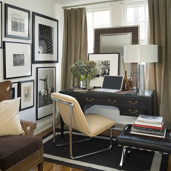 David Jimenez - dens/libraries/offices - black desk, taupe curtains, taupe drapes, taupe window panels, taupe velvet curtains, taupe velvet drapes, desk in front of window, border rug, Fulton Zebrawood Mirror,