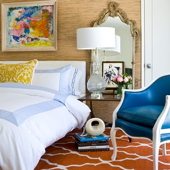 David Jimenez - bedrooms - trellis rug, orange rug, orange trellis rug, white headboard, white slipcovered headboard, white and blue bedding, peacock blue chair, grasscloth, grasscloth wallpaper, chain link bedding, chain link duvet, chain link shams, peacock blue leather chair, damask pillow, yellow damask pillow,