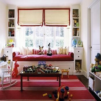 Peter Dunham Design - girl's rooms - daybed, built in daybed, kids daybed, girls daybed, built ins, built in cabinets, red rug, striped red rug, grosgrain roman shades, plat table, built in window seat, daybed window seat, window seat daybed,