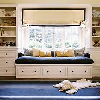 Peter Dunham Design - boy's rooms - ivory, roman shade, black, ribbon trim, blue, bench, cushion, built-ins, window seat, cabinets, shelves, blue, striped, rug, yellow, walls, paint color, blue, boy's playroom,