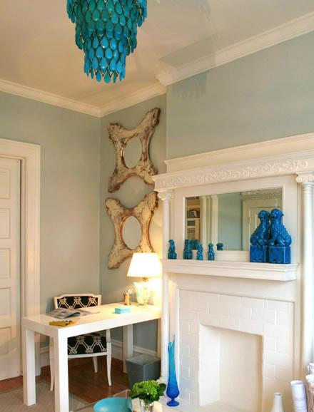 Massucco Warner Miller - dens/libraries/offices - West Elm Parson Desk, turquoise accents, turquoise blue accents, turquoise chandelier, turquoise blue chandelier, foo dogs, turquoise foo dogs, turquoise blue foo dogs, parsons desk, white parsons desk,