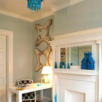 Massucco Warner Miller - dens/libraries/offices - turquoise accents, turquoise blue accents, turquoise chandelier, turquoise blue chandelier, foo dogs, turquoise foo dogs, turquoise blue foo dogs, parsons desk, white parsons desk, , West Elm Parson Desk,