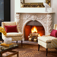 Shaun Jackson Design - living rooms - fireplace seating, chair sin front of fireplace, zebra chairs, yellow chairs, yellow zebra chairs, white and yellow chairs, white and yellow zebra chairs, ornate fireplace, ornate stone fireplace, twig table, twig accent table, brass twig table, Rubie Green Mary Fabric, Global Views Twig Table,