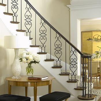 Jan Showers - entrances/foyers - iron spindles, ornate spindles, ornate iron spindles,  White lamp, black X-stools, walnut entry table, white