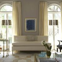 Jan Showers - living rooms - geometric rug, abstract art, greek key, polished, chrome, bar cart, lamps, leather, settee, ivory, drapes, ivory, yellow, blue, graphic, rug, soft, gray, walls, living room, ivory drapes, ivory curtains, ivory window panels,