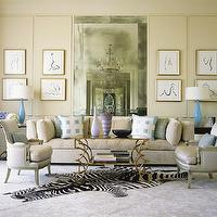 Jan Showers - living rooms - zebra, cowhide, rug, beige, sofa, silk, chairs, beveled, floor, mirror, blue, silk, pillows, blue, lamps, art,