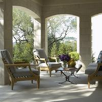Jan Showers - decks/patios - wood furniture, patio, iron cocktail table, arched doorways,  Outdoor space with gray outdoor seating and iron cocktail