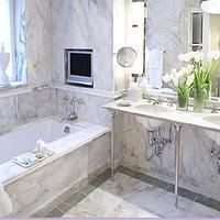 bathrooms - marble, console vanities, double vanities, bathroom, marble bathroom, white marble bathroom, bathroom tv, tv niche, bathroom tv niche, marble double washstand,