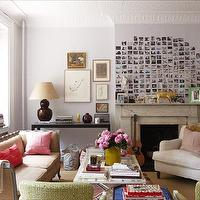 Domino Magazine - living rooms - lilac, walls, paint, color, polaroid, photo gallery, marble, fireplace, white, branch, floor lamp, maroon, gourd, lamp, black, console, table, photo walls, photo wall collage, photo wall ideas, family photo walls,