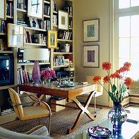 Jan Showers - dens/libraries/offices - jan showers, bookshelves, animal rug, office, library,  Sand beige flat bar chairs, walnut x desk, purple