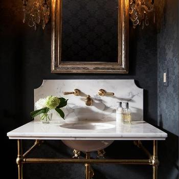 Ashley Goforth Design - bathrooms - flocked wallpaper, black flocked wallpaper, damask wallpaper, black damask wallpaper, powder room, powder room wallpaper, arched mirror, marble washstand, antique brass washstand, antique brass faucet, antique brass bathroom faucet, marble backsplash, washstand backsplash, powder room wallpaper, black powder room wallpaper,