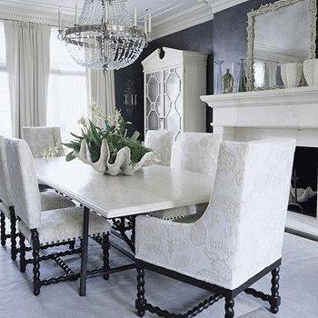 dining rooms - decorative clamshell, decorative clam shell, oversized clam shell, upholstered dining chairs, spindle dining chairs, dining room fireplace, mirrored armoire,