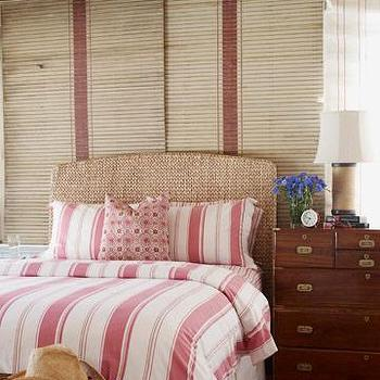 House Beautiful - bedrooms - seagrass headboard, striped bedding, white and red bedding, striped duvet, striped shams, white and red striped bedding, white and red striped duvet, campaign chest, chest as nightstand,