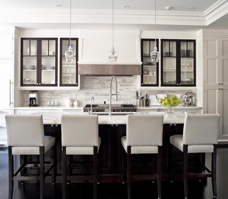 Jennifer Worts Design - kitchens - glass front kitchen cabinets, two tone cabinets, two tone kitchen cabinets, linear marble tiles, linear marble backsplash, off white bar stools, off white counter stools, upholstered bar stools, upholster counter stools, espresso kitchen island,