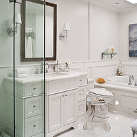 Jennifer Worts Design - bathrooms - frameless glass shower, white bathroom vanity, marble countertops, lucite stools, lucite stool, lucite ottoman. lucite bathroom stools, trim molding, bathroom trim molding, Acylic Stool Magazine Rack, Fulton Zebrawood Mirror, Robert Abbey Muse - One Light Crystal Wall Sconce,