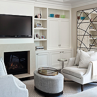 Jennifer Worts Design - bedrooms - sitting area, TV over fireplace, built ins, tv built ins, tv built in cabinets, tv storage, bedroom sitting area, oval ottoman, velvet oval ottoman, oval velvet ottoman, gray velvet ottoman, gray oval ottoman, bedroom chairs, bedroom fireplace, master bedroom fireplace, bedroom built ins, bedroom built in cabinets,