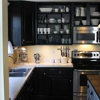 Whimages - kitchens - Behr - Beluga - Black cabinets, painted black cabinets, painted oak, yellow kitchen, black kitchen, reclaimed wood counters, corbels, open shelving, crown molding, tall cabinets, white dishes, crown molding, open shelves, tiled floors, mixer, storage canisters, stainless steel holder,