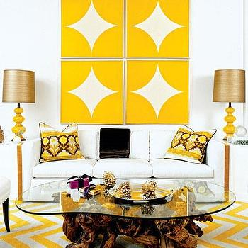 Pieces Inc - living rooms - chevron rug, yellow chevron rug, white and yellow chevron rug, driftwood coffee table, white and yellow living room, white sofa, yellow lamps, art deco lamps, art over sofa,