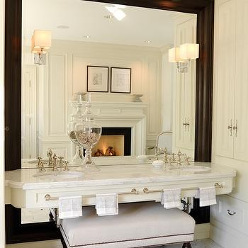 House & Home - bathrooms - floating vanity, floating bathroom vanity, his and her sinks, marble vanity, floating marble vanity, vanity bench, framed floor mirror, vanity in front of floor mirror, bathroom vanity in front of floor mirror, nailhead bench, bathroom bench, bathroom vanity bench,