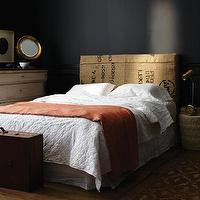 House & Home - bedrooms - black walls, black walls, black paint, black paint color, grain sack headboard, vintage grain sack headboard, orange throw, orange throw blanket,