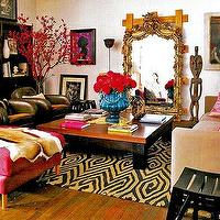 living rooms - ornate floor mirror, gold floor mirror, gold ornate floor mirror, square coffee table, eclectic living room, pink ottoman, pink velvet ottoman,