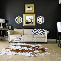 living rooms - Valspar - New Black - black, wall, lucite, table, vintage, bar cart, ikea, barstools, cowhide, rug, sunburst, mirrors, black walls, black paint, black paint color,