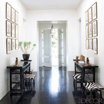 Elle Decor - entrances/foyers - wood floors, french doors, zebra ottoman, zebra bench, black foyer table, black console table,  Megan Mullally's