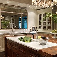 House & Home - kitchens - calcutta, marble, countertops, cutting board, walnut, stained, island, ivory, glass-front, kitchen, cabinets, crystal, chandelier, wood color,