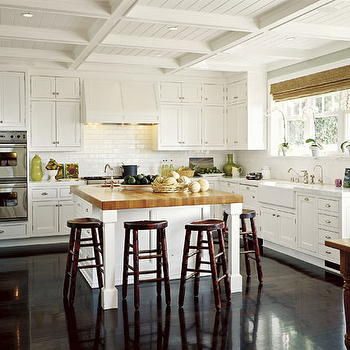 kitchens - coffered ceiling, kitchen coffered ceiling, white cabinets, white kitchen cabinets, two tone countertops, ceiling height cabinets, ceiling height cabinetry, ceiling height kitchen cabinets, butcher block top, island with butcher block top, butcher block countertop, tractor bar stools, paneled range hood, glossy wood floors, high gloss wood floors, farmhouse sink,