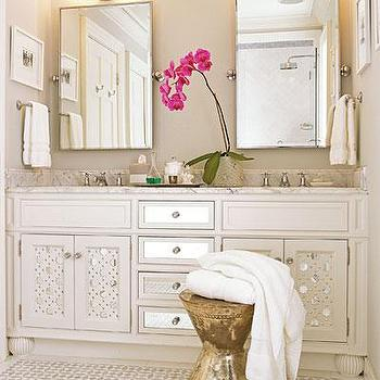Southern Living - bathrooms - mirrored bathroom vanity, white mirrored bathroom vanity, mirrored cabinets, mirrored bathroom cabinets, white mirrored cabinets, white mirrored bathroom cabinets, hourglass stools, metal stool, metal hourglass stool, rectangular pivot mirror, picot mirrors,