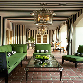 Rios Clementi Hale Studios - decks/patios - stripe wall, striped wall, black and white striped wall, white and black striped wall, green cushions, kelly green, kelly green cushions, green outdoor furniture, brick pavers, covered patio, green outdoor sofa, green outdoor chair,