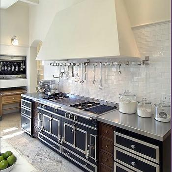 kitchens - la cornue range, subway tiles, wall mounted utensils rack, kitchen utensils rack, subway tiled backsplash, stainless steel countertops,
