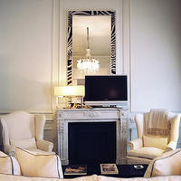 J.K. Place Hotel - living rooms - mirror above fireplace, mirrors above fireplace, mirror over fireplace, mirrors over fireplace, fireplace mirror, fireplace mirrors, zebra mirror, wingback chairs,