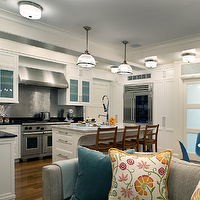 Cullman & Kravis - kitchens - creamy, white, glass-front, kitchen, cabinets, stainless steel, backsplash, marble, countertop, honed, black, countertop, gray, ribbed, sofa, turquoise, blue, velvet, pillow, floral, pillow,