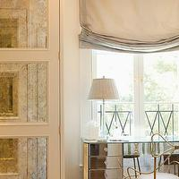 Elizabeth Dinkel Design - bedrooms - mirrored vanity, mirrored closet doors, antique mirrored closet doors, antiqued mirrored closet doors, mirrored make up vanity, gray roman shade, mirrored cabinets, antique mirrored cabinets, antique mirrored cabinets,