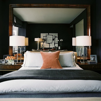 Ron Marvin - bedrooms: mirror as headboard, mirror used as headboard, gray velvet blanket, persimmon pillow, persimmon velvet pillow, masculine bedroom, crystal bedroom lamps, crystal table lamps,
