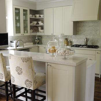 Sarah Richardson Design - kitchens - ivory cabinets, ivory kitchen cabinets, kitchen peninsula, painted cabinets, painted kitchen cabinets, ivory painted cabinets, ivory painted kitchen cabinets, paneled range hood, upholstered bar stools, upholstered counter stools, raised breakfast bar,