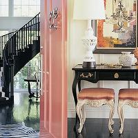 Kelly Wearstler - entrances/foyers - iron stair railing, black stair railing, stair railing, pink door, pink stools, french stools, french pink stools, pink french stools, black console table, french console table, black stair runner, black and white stair runner, winding staircase, black staircase, black winding stircase,