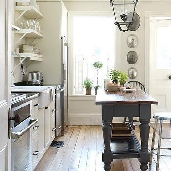Margot Austin - kitchens - gray kitchen island, painted kitchen island, charcoal gray kitchen island, butcher block top, island with butcher block top, gray island with butcher block top, white kitchen cabinets, farmhouse sink, kitchen shelving,