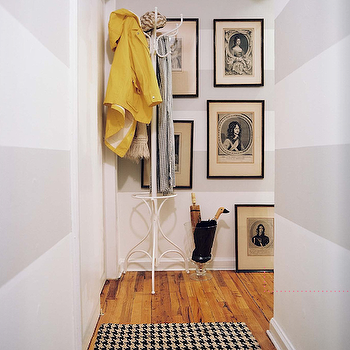 entrances/foyers - umbrella holder, art gallery, horizontal striped, horizontal wall stripes, horizontal stripes on walls, horizontal striped walls, houndstooth rug,