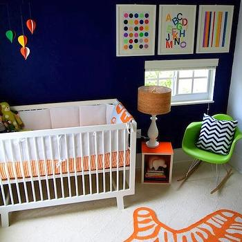 nurseries - Giggle.com Bedding, Oeuf Furniture, Eames Rocking Chair, Artwork by Samantha Kurland, blue walls, blue paint, blue paint color, blue nursery walls, blue nursery paint, blue nursery paint color, orange zebra rug, nursery zebra rug, green rocker, green molded plastic rocker, nursery rocker, green nursery rocker, Jonathan Adler Zebra Rug,