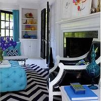 Jonathan Adler - living rooms - turquoise, black and white, chevron, rug, blue, turquoise ottoman, tufted ottoman, turquoise tufted ottoman,