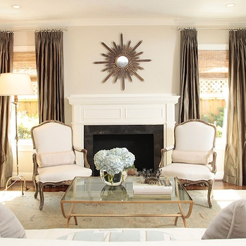 Ashley Goforth Design - living rooms - coffee table, brass coffee table, brass and glass coffee table, brass glass coffee table, taupe curtains, taupe drapes, taupe silk curtains, taupe silk drapes, french chairs,