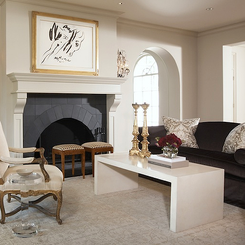 Ashley Goforth Design - living rooms - charcoal gray sofa, velvet sofa, charcoal gray velvet sofa, waterfall coffee table, white waterfall coffee table, white lacquer coffee table, arched doorway,